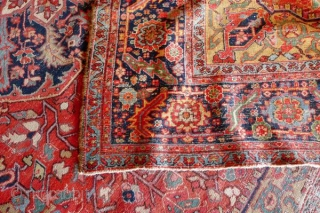 """As found: A beautiful turn of the century Antique Heriz measuring 9'3""""x 11'3"""" with wear.  Thanks for looking."""