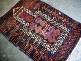 Stunning old balochi prayer rug with good rich colors.