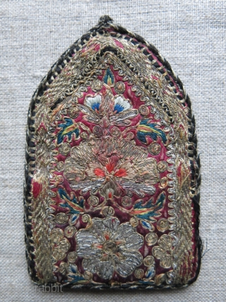 Safavid Surmedan - silk and metallic embroidery make up bag for females. Inside has the sign of black powder used for the eyes. Lined with brocade fabric. Circa - Late Safavid   ...