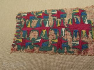 "Green Turkmen Chirpy fragment. Professionally mounted on fabric. Size of the fragment: Width 3"" to 5"" -8 cm to 13 cm wide and height is 12.5"" - 32 cm."