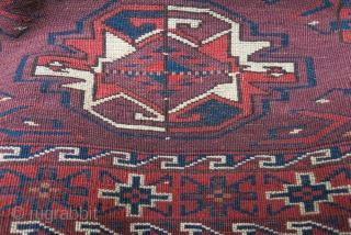 "Turkmen Yomud Chuval, symmetric knots, very fine wool with saturate colors, tiny hot red center of  ""Guls"", full pile with a small damgae area on top right corner. Circa 1900 -  ..."