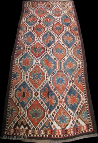 "Uzbek Julkur ikat design rug, very small prof. restorations. Four panels, Size: 47"" x 126"" - 120 cm x 302 cm."
