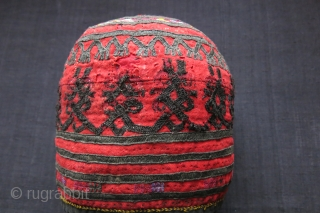 Central Asia Turkmenistan tribal ceremonial tall hat - possibly Ersary. Silk embroidery on trade wool cloth, lined with hand loomed cotton. It used to have silver buttons all over and they must  ...