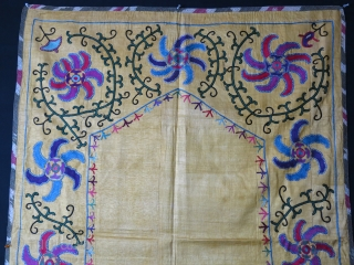 Uzbekistan – Shahrisabz – Lakai tribal antique Suzani. Fine Lakai chain stitch embroidery on yellow Adras plain IKAT. Overall, it is in great condition besides couple tiny pale stains. Pinwheels floating around  ...