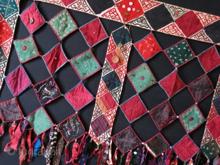 """Ersary Turkmen asmalyk - yurt hanging. silk - cotton - wool square pieces put together with fabric tassels. decorated with coins and various buttons. Very good shape. Size : 36"""" X 25""""  ..."""