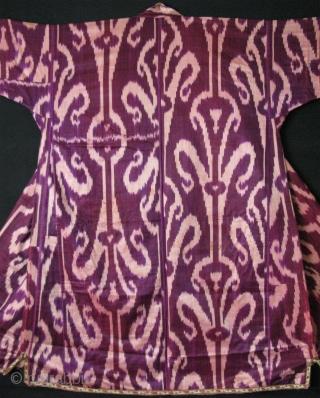 "Tajikistan Khan Alas silk ikat chapan. Russian printed cotton lining. Circa 1900. Size: Arm to arm; 80"" - 205 cm, Height; 56"" - 143 cm, Armpit;33""- 84 cm and Skirt; 46""- 118  ..."