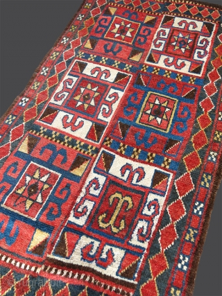 Uzbekistan – Julkhur tribal, four-panel, all wool rug. Julkhur rugs are very unusual in their construction, made in a way that contributes to their bold appearance. They are initially woven in narrow  ...