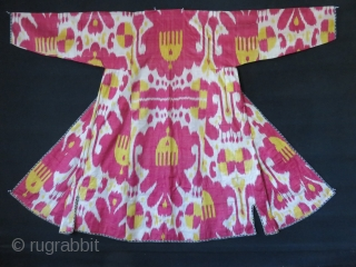 Uzbekistan – Bokhara antique Silk adras Ikat chapan. Saturated yellow and light cocheneal colors are used in a harmony. Lined with printed floral design cotton and cotton facing. It is in pretty  ...