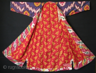 "Uzbekistan shoi ikat chapan. Some images has sunshine on them. Size: Arms spread out 57"" - 146 cm, Height 49"" -126 cm, skirt 36"" - 92 cm."