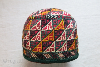 "Turkmen Chodor tribal ceremonial silk emrboidery hat. lined with printed cotton and quilted inside, silk embroidered trim with great condition. saturated natural dyes. Circa - 1900-1920s size : 7"" in diameter -  ..."
