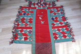 Central Asian - Turkmen ceremonial Camel trapping. made from broadcloth decorated with glass buttons, bird of pray feathers and other talismanic objects. Fairly in tact and good condition. Circa early 20th century,  ...