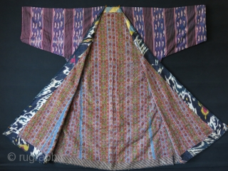 Tajikistan soft Shoi Ikat Chapan. Lined with printed Russian cotton and faced adras ikat. Indigo dyed lining inside of arms. A small pale stain on back side. Circa 1900 or earlier size:  ...