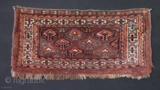 "Turkmen Yomud torba. Minor old yarn repairs. Good pile. Symmetrical knots. Circa 1900s. Size: 28"" x 13"" - 71cm x 33cm."