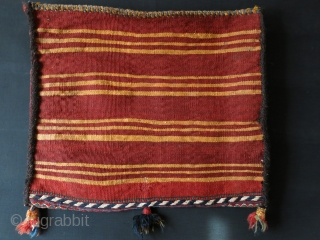 South west of Iran - Qashkai tribal single side of a double bag. Natural colors, coarse sumak weave with goat hair side wrapping. Small repaired hole on back side. Circa 1920s