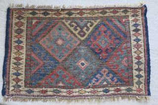 """Jaff mini Kurdish bag face. Upper ivory border has repaired with old wool. usual saturated colors. Circa 1900. Size: 19"""" X 11.5"""" - 48 cm X 29 cm"""
