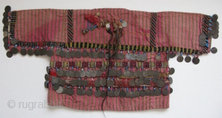 "Anatolian Turkmen silk child's ceremonial jacket. Amulets and Talismanic pieces on the back. Ottoman coins from 19th. century. Size: 12"" x 25""(30cm x 63cm)"