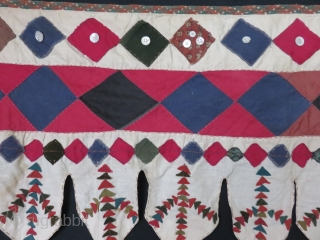 Turkmen yurt hanging, various left over velvet, cotton, wool materials are recycled to save to create such a yurt decoration. They usually would have fabric tassels at bottom end of lappets. Still  ...