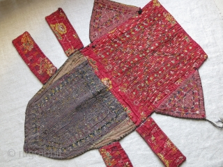 Turkmen tekke Camel trapping fragment. Fine Tekke silk embroidery with great colors. bird feather and hair ornaments on upper part, printed cotton backing. Very little wear on between upper and lower parts.  ...
