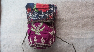 "Azerbaijan silk embroidered pouch. Very fine Chain and Bird's eye embroidery on silk.braided metallic and silk thread locking yarn with silk tassels. Printed cotton lining. Circa 1900. Size: 6"" by 4"""