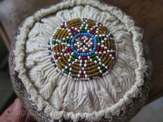 "Anatolian hat made in Bursa by Turkmens. Very fine silk embroidery on cotton and glass beads. Size: in diameters 6"" - 15 cm and height 2.5"" - 6.5 cm."