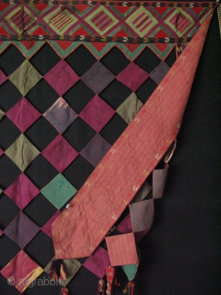 """Turkmen Tekke Patchwork Asmalyk with traditional talismanic owner's hair and wool + silk tassels. Circa 1920 - 30's. Size: 35"""" x 47"""" - 90cm x 119cm."""