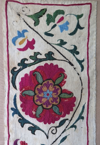 "Uzbekistan Suzani fragment from 19th century. Silk embroidery on cotton. Professionally mounted. Size: 9.8"" x 50.6"" - 25 cm x 129 cm."