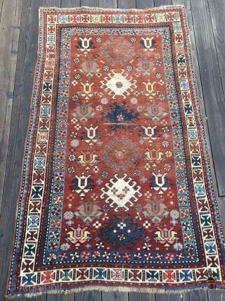 Unusual Antique Caucasian Rug, late 19th Century. Bright saturated colors, mostly all natural with the exception of a light red and possibly the pink. Unusual tulip design field. White main border with  ...