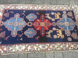 A charming antique Persian Bakhtiary tribal rug with animals, size: 195x120cm / 6'4''ft x 4ft