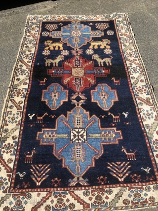 Look at the lions and giraffes in this playful and lovely antique Persian Bakhtiary tribal rug, size: 195x120cm / 6'4''ft x 4ft