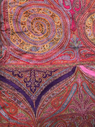Beautiful antique kashmir shawl very bright colours. It measures 10.5 feet long and 4.5 feet wide. Some moth holes but over overall very good condition.