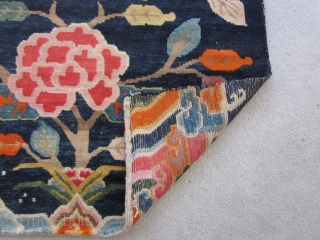 Tibetan : Khaden : Lotuses and other floral elements on saturated indigo ground. Tree of life motif. Foldover shot shows some small repair to lower selvedge, c.1930