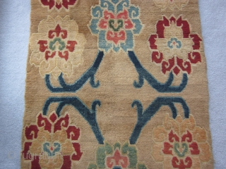 Tibetan khaden, abt 3 by 6 ft, c.1925, with spacious flower and vine design on tan ground