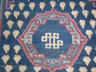 Tibetan: Khaden, about 3 by 6 ft., chunky feel, before 1900 frog's foot design, endless knot motif, some repair. Inexpensive