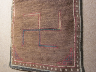 Tibetan, CORRECTION) Two large swastikas on brown field with small corner frets; exhibited at 1998 ACOR Conf., Denver: 27 by 62 inches, post-1900