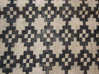 """Tibetan mat, with overall geometric design, possibly cut down from larger rug, 2'8"""" by 3' c.1900 Signs of wear. Not expensive."""