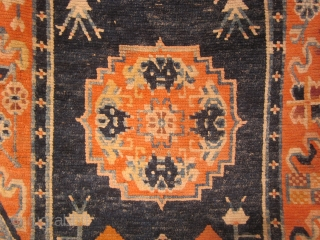 """Tibetan: Long runner, 35 by 88 inches, three """"coin"""" design, with floral elements. C 1930, red corduroy surround."""