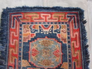 "Tibetan long three ""gul"" khaden with blue fuzzy border, post-1900, 32 by 64 inches, excellent condition."