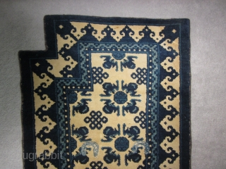 Chinese Ningshia bottom saddle rug, early 20th, 24 by 52 inches. Plush wool. Excellent condition with secured selvedges and over-sewn cinch strap holes SOLD