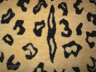 Tibetan tiger pelt fragment as pillow, 15 by 17 inches
