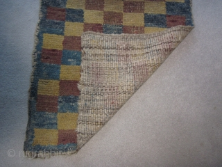 Tibetan khaden, village loosely woven checkerboard, warp-faced back construction,. abt 28 by 60 inches, a few minor reweaves, pre-1900.POR