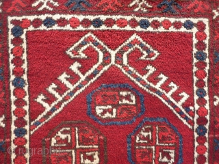 """A soft, glossy and shinny prayer rug woven by ethic Uzbeks in Afghanistan. The 11 güls in the field are framed by a hooked Mihrab. The little """"flowers"""" in the two white  ..."""