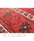 This prayer rug has a more formal border that constrasts with an unusual mihrab surrounded by two water jugs and randomly scatered motives. Tightly woven with nice shinny wool. The area where  ...