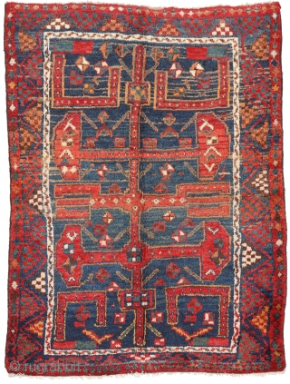 A very unusual and archaic looking Luri rug. Nice abrash and colour changes. Soft and shinny wool, all natural dyes, in mint condition. You can purchase this unusual rug directly from our  ...