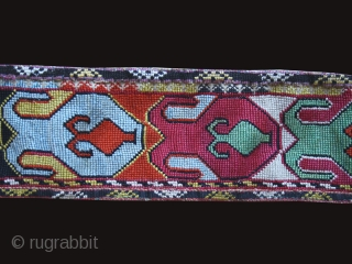 Cross stitch embroidered belt or robe trim cod. 0668. One of the item posted on my new website www.nonplusultra.cloud. Silk, cotton, traditional dyes backed with ikat. Central Asia.19th. century. Cm. 108 x  ...