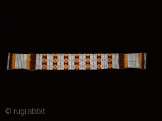 "Wool and cotton women's belt ""kourzia"" cod. 0333. Beni Mesguilda Berber people. Western Rif. Morocco. Early 20th. century.Dimension cm. 297 x 33 ( 117"" x 13""). Some condition issue.