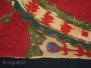 """Suzani fragments cod. 0494. Silk embroidery on cotton, traditional dyes. Central Asia. Mid. 19th. century. Very good condition. Cm. 65 x 150 (2'2"""" x 4'11""""). Professionally sewn onto a cotton black ground  ..."""