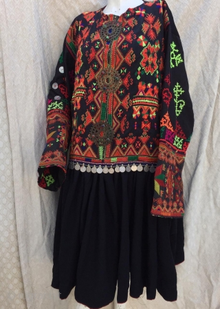 Tribal vintage woman dress from Kohistan Valley in northern Pakistan.  The embroidery is very fine and pure handmade. The dress is in its best condition