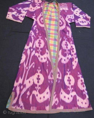 Uzbek ikat Kaftan with little stain .