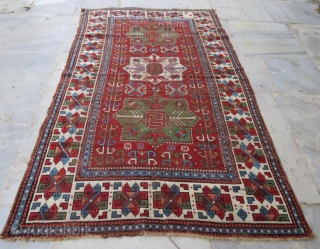early Caucasion rug with damage,250 x 152 cm