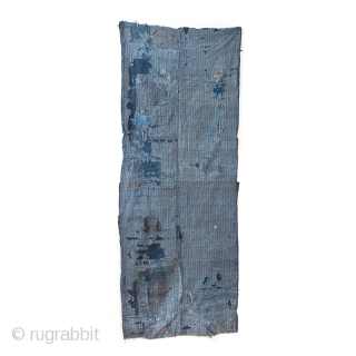 This is a large, heavily patched fragment of a Japanese boro futon cover. There are over sixty pieces of cloth on this textile, which have been sashiko stitched on top of one  ...